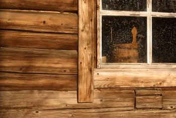 A wood window frame has a rustic appeal.