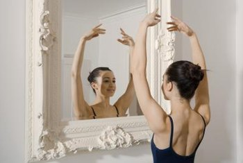 Pointe shoes and a mirror are essential equipment for a ballerina.