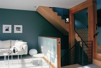 There are several appealing techniques for bringing together a living room and a staircase using paint.