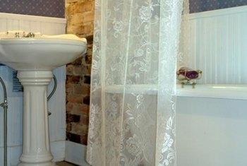 20s Bathroom Design | Home Guides | SF Gate on bathroom designs corner bath tubs, bathroom renovations with claw tubs, bathroom alcove tub, small bathrooms with claw tubs, gardens with claw tubs,