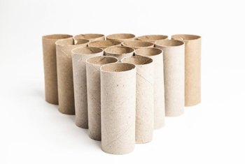 Slice carefully to create several napkin rings from one cardboard tube.