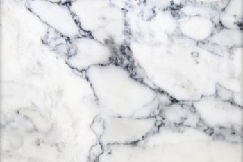 Study images of actual marble to determine colors and styling for the faux finish.