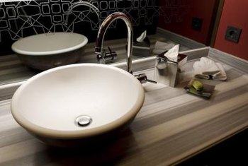 A Vessel Sink Offers An Easy Installation Atop A Repurposed Vanity.