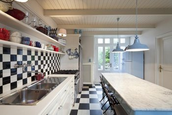 Black-and-white tiles coordinate with glass accents in either pastels or saturated color.