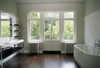 Retractable screens tuck discretely away similar to rolling window shades.