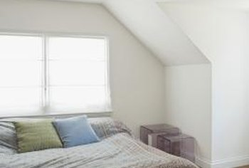 Think outside the bed to access your small alcove's potential.