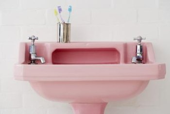 Preserve the pink, and think of vintage fixtures as antiques.
