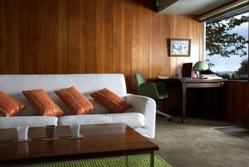 Refinishing wood paneling can instantly update it.