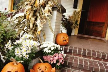 Seasonal decor dresses up the front porch at little cost.