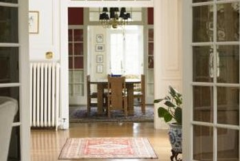 Rugs warm hardwood floors but they need a latex backing to prevent slipping.