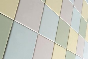 Change the color of outdated glazed tiles by painting over them.