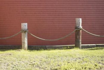 Fashion a rope fence with wood posts and rope.