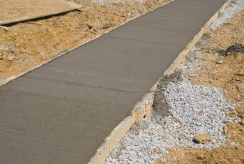 A Concrete Sidewalk Typically Is Strengthened By Steel Mesh Within The Poured