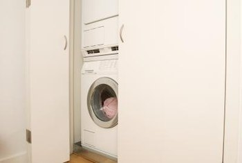 Installing a stackable washer-dryer in the kitchen adds laundry facilities to a small living space.