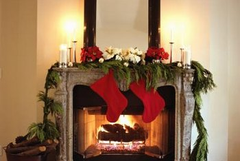 Natural greenery, red stockings and candelight glow deliver Old World holiday charm.
