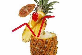 Use hollowed-out pineapples for drinks to complement the decor on the tables.