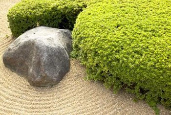 Sand represents water in a zen garden.