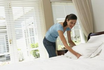 Make your bed every morning and smooth the topper with your hands for a flat, even surface come nightfall.
