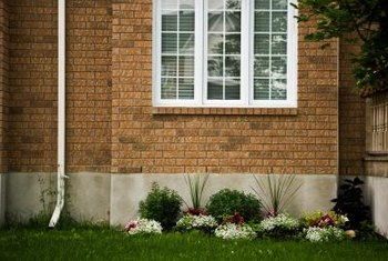 A gutter downspout can provide you with free rainwater for your garden.