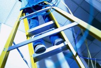 A sturdy stepladder is a must when installing bath fans in suspended ceilings.