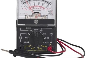 A voltmeter checks the battery charge to ensure proper starter operation.