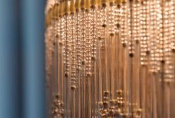 Beaded fringe can transform a lampshade into a ceiling fixture cover.