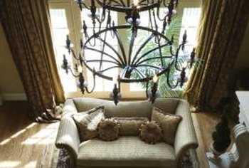 This candelabra-style wrought-iron chandelier is an Old World lighting accessory.