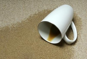 A paper or cotton towel is the first defense to use when attacking a carpet stain.