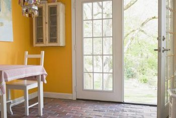 Use inexpensive molding to mimic the panes of a traditional French door.
