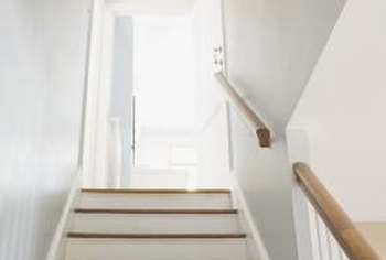 White risers contrast the darker stained steps and brighten this narrow stairway.