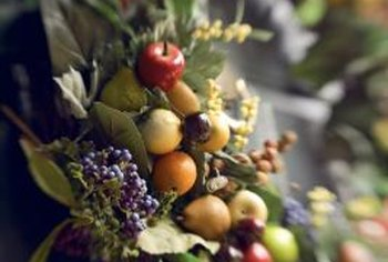 Combine berries, evergreens and crabapples for a holiday wreath.