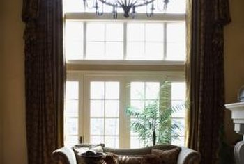 Alter the shape of a square window with an arched cornice board.