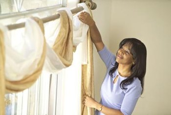 Use your imagination when hanging window scarves, or aim for a more traditional draped look.
