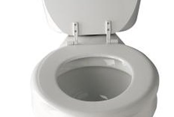 Close the lid and wiggle the seat to see where it's attached to the commode.