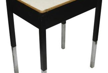 A tabletop can be lowered by cutting the legs to the requisite height.