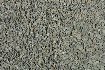 Smaller diameters of crushed stone compacts easier to avoid shifting.
