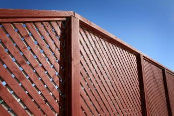 Enhance a fence's natural red cedar color with semi-transparent or opaque stain.