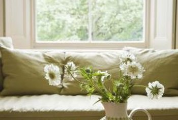Beautify a primitive coffee table with a simple bouquet of daisies.