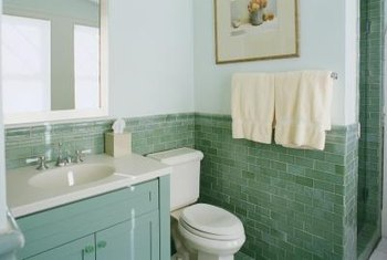 What Type of Paint to Use on Bathroom Cabinets. Choose a durable, water-resistant paint for bathroom cabinets.