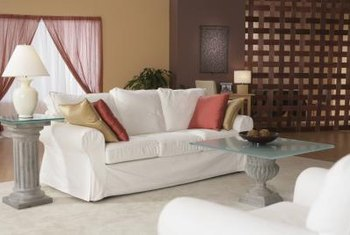 A white slipcover can add life to an old sofa.