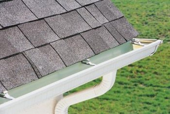 Rain gutters collect water and carry it to a downspout.