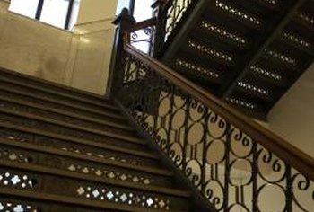 Iron banisters can be used to complement a wooden handrail.
