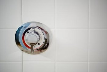 If your tile wall looks discolored or grimy, remove the plate to clean the area.