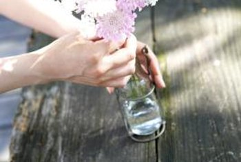 You can reuse recyclable items, such as glass bottles and jars, as flower vases.