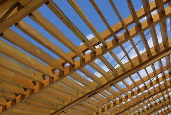 Ceiling joists may hang between a beam and a wall top plate.