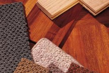 Apply double-stick tape to the corners of carpet tiles.