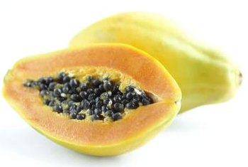 The skin of a golden papaya turns yellow as it ripens.