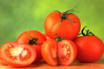 Tomato plants prefer evenly-moist soil.