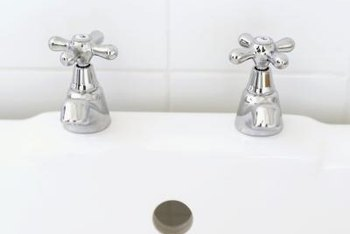Grime and hard water can dull a white ceramic sink.