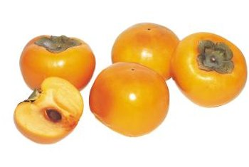 Persimmons Are Orange Red In Color And Resemble Tomatoes